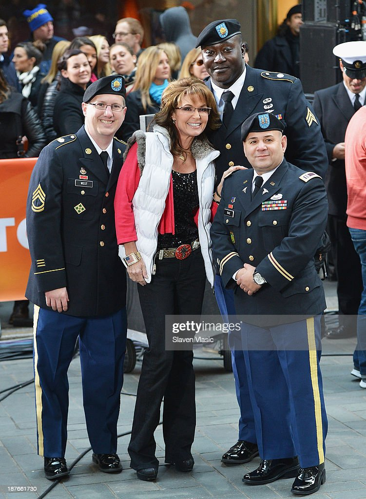 Former Governor of Alaska <a gi-track='captionPersonalityLinkClicked' href=/galleries/search?phrase=Sarah+Palin&family=editorial&specificpeople=4170348 ng-click='$event.stopPropagation()'>Sarah Palin</a> (C) visits NBC's 'Today' at the NBC's TODAY Show on November 11, 2013 in New York, New York.