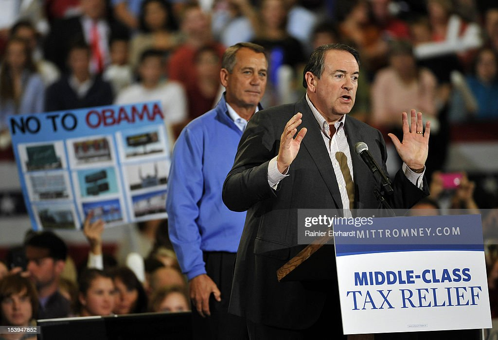 Former governor of Arkansas <a gi-track='captionPersonalityLinkClicked' href=/galleries/search?phrase=Mike+Huckabee&family=editorial&specificpeople=226521 ng-click='$event.stopPropagation()'>Mike Huckabee</a> (R) speaks as U.S. Speaker of the House (L) <a gi-track='captionPersonalityLinkClicked' href=/galleries/search?phrase=John+Boehner&family=editorial&specificpeople=274752 ng-click='$event.stopPropagation()'>John Boehner</a> (R-OH) looks on during a campaign rally for Republican presidential candidate, former Massachusetts Gov. Mitt Romney on October 11, 2012 in Asheville, North Carolina. Romney is campaigning in North Carolina with less than a month to go before the general election.