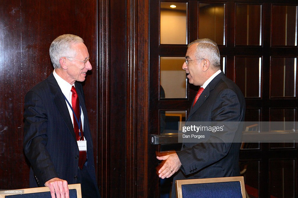 Former Governor of the Bank of Israel Professor Stanley Fischer talks with former Prime Minister of the Palestinian Authority Salam Fayyad during a...