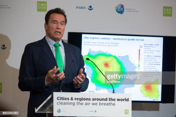 Former Governor of the US State of California Arnold Schwarzenegger addresses a press conference on the air quality in big cities in Paris on...