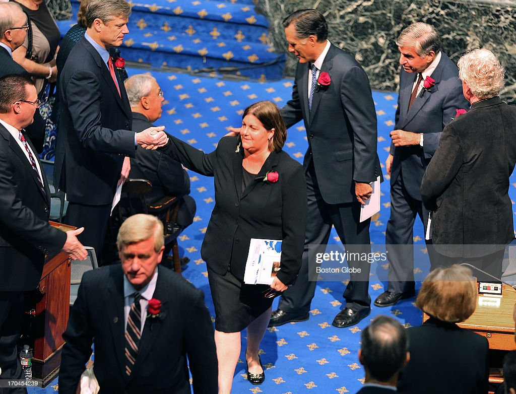 William Weld, Jane Swift, Mitt Romney and Michael Dukakis, follow the procession out after the service. Friends, family, and local politicians attended a memorial service for former Governor Paul Cellucci at the Massachusetts State House, June 13, 2013.