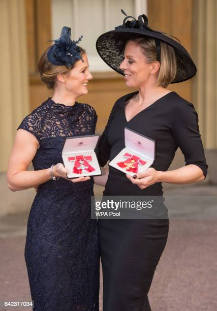 Former Great Britain hockey captain Kate RichardsonWalsh and her wife Helen RichardsonWalsh pose after the investiture ceremony where they received...