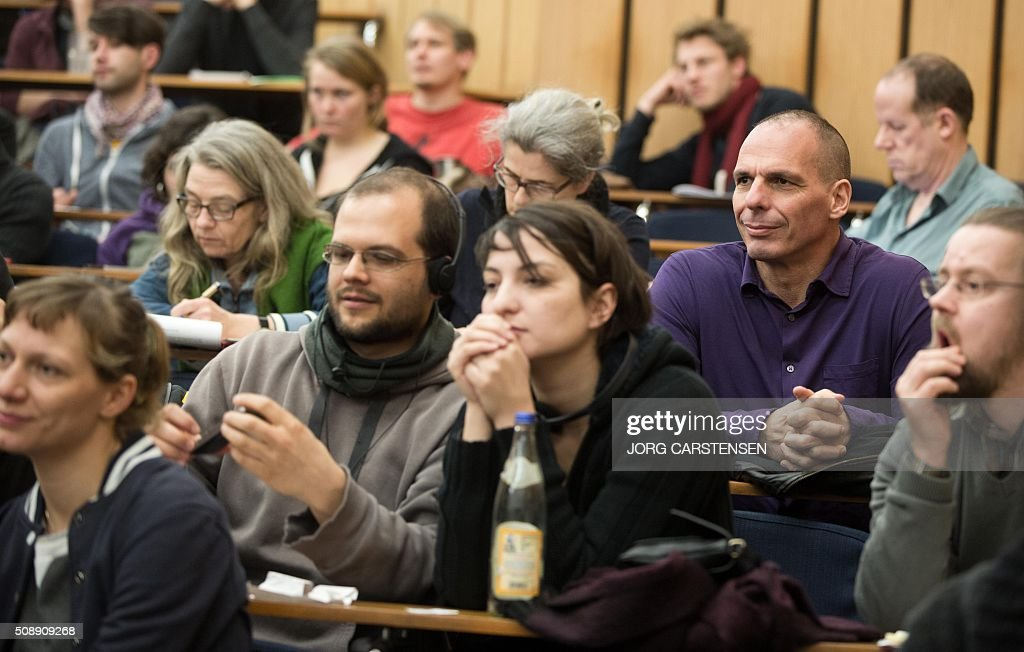 Former Greeek finance minister Yanis Varoufakis (R) attends a meeting of the Blockupy movement in Berlin on February 7, 2016. / AFP / dpa / Jörg Carstensen / Germany OUT