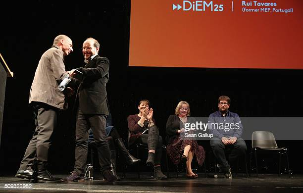 Former Greek Finance Minister Yanis Varoufakis embraces Rui Tavares of Portugal after Tavares spoke at the official launch of the Democracy in Europe...