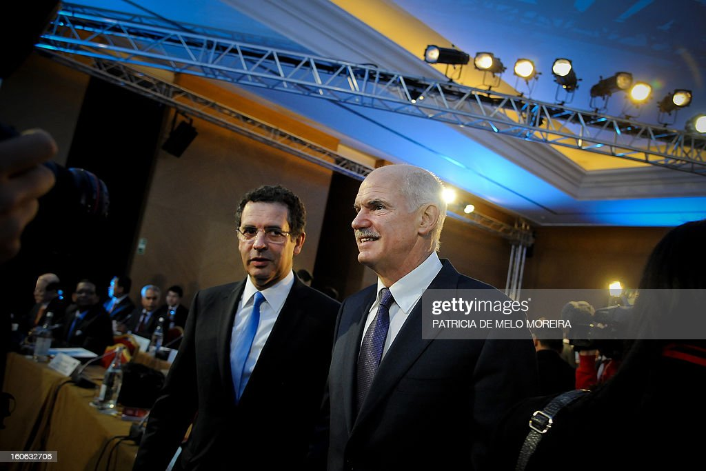 Former Greek Prime Minister and President of the Socialist International George Papandreou flanked by Portugal's Socialist Party leader Antonio Jose...