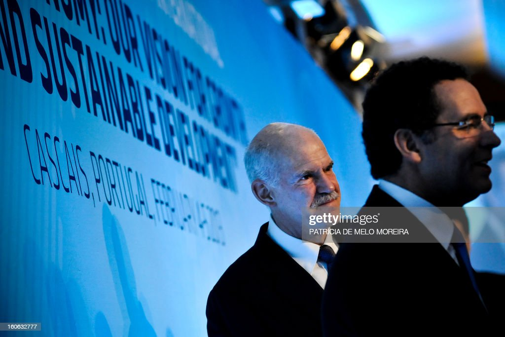 Former Greek Prime Minister and President of the Socialist International George Papandreou and Portugal's Socialist Party leader Antonio Jose Seguro...