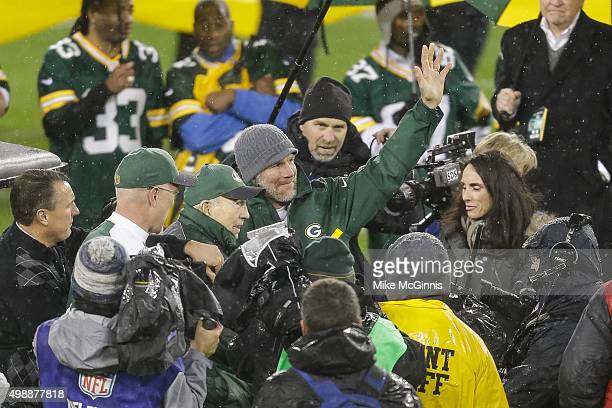 Former Green Bay Packers quarterbacks Bart Starr and Brett Favre address the crowd during Favre's jersey retirement ceremony at Lambeau Field on...