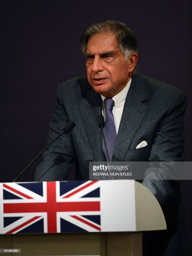 Former Group Chairman of Indian conglomerate Tata Group, Ratan Tata speaks at a business seminar attended by Indian industrialists and a huge business delegation accompanying British Prime Minister David Cameron in Mumbai on February 18, 2013. British Prime Minister David Cameron arrived in India on Monday with what he called Britain's biggest ever overseas business delegation for a three-day visit clouded by a corruption scandal. AFP PHOTO/Indranil MUKHERJEE