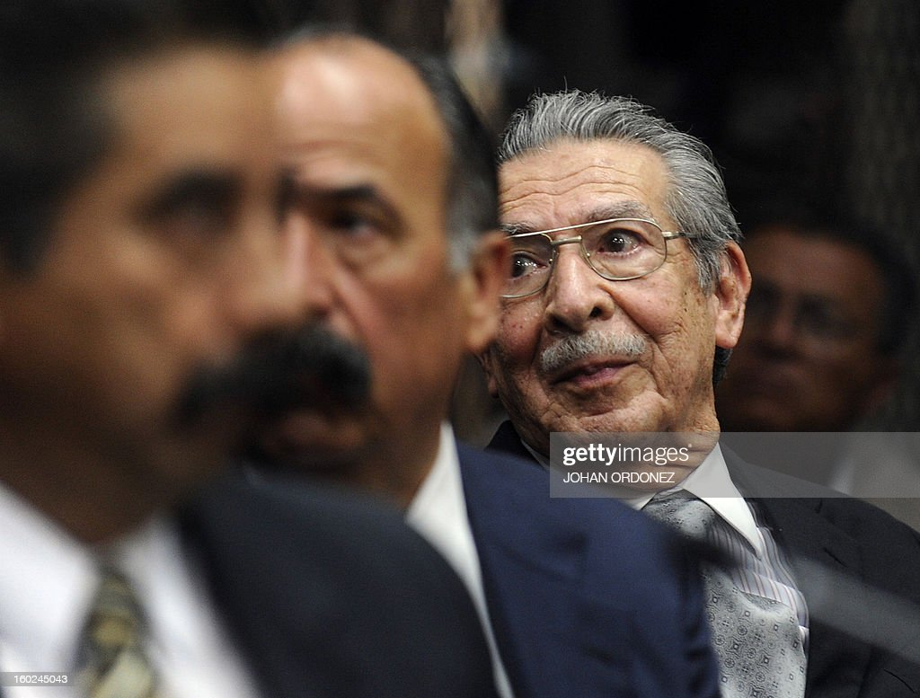 Former Guatemalan de facto President (1982-1983) and retired General Jose Efrain Rios Montt (R), gestures during a court hearing in Guatemala City on January 28, 2013. In a historic decision, a Guatemalan court announced today that Rios Montt, 86, will face trial for the genocide of indigenous peoples during his rule, becoming the first former president to be prosecuted for this crime in the country. The landmark decision marks the first time that genocide proceedings have been brought in the country over the 36-year civil war that ended in 1996, leaving an estimated 200,000 people dead, according to the UN. AFP PHOTO/Johan ORDONEZ