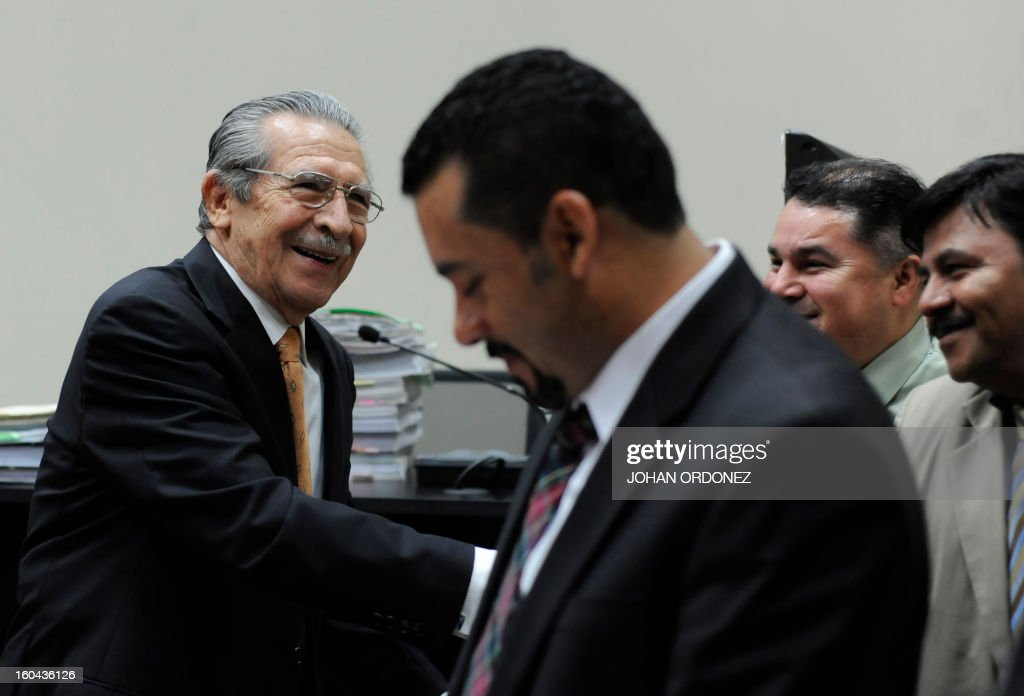 Former Guatemalan de facto President (1982-1983) and retired General Jose Efrain Rios Montt (L), greets members of the Public Prosecutor Office before a court hearing in Guatemala City on January 31, 2013. A Guatemalan judge started the hearing to receive evidence for the open trial to Rios Montt on charges of genocide committed in indigenous populations during his de facto regime between 1982 and 1983. AFP PHOTO/Johan ORDONEZ