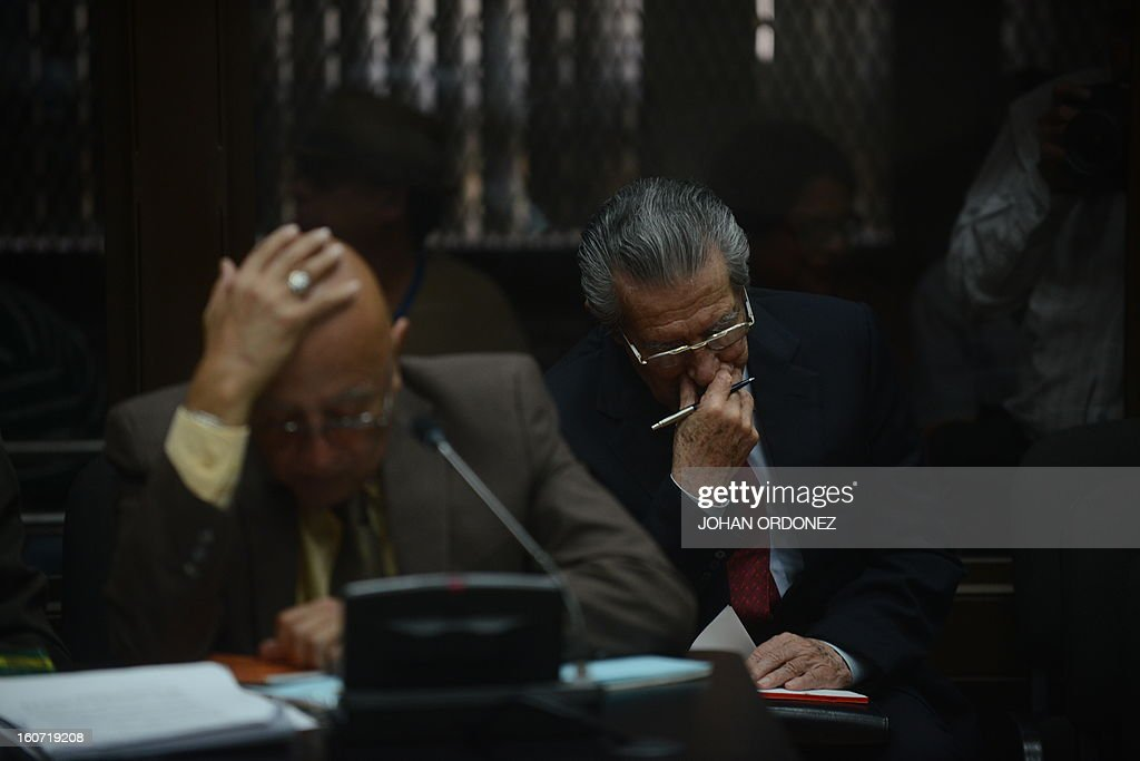 Former Guatemalan de facto President (1982-1983) and retired General Jose Efrain Rios Montt(R) is seen with Danilo Rodriguez, one of his lawyers, during a court hearing in Guatemala City on Febrary 4, 2013. Guatemalan judge Miguel Galvez defined this Monday the court members to prosecute Ríos Montt, on charges of genocide committed in indigenous populations during his de facto regime between 1982 and 1983. AFP PHOTO/Johan ORDONEZ