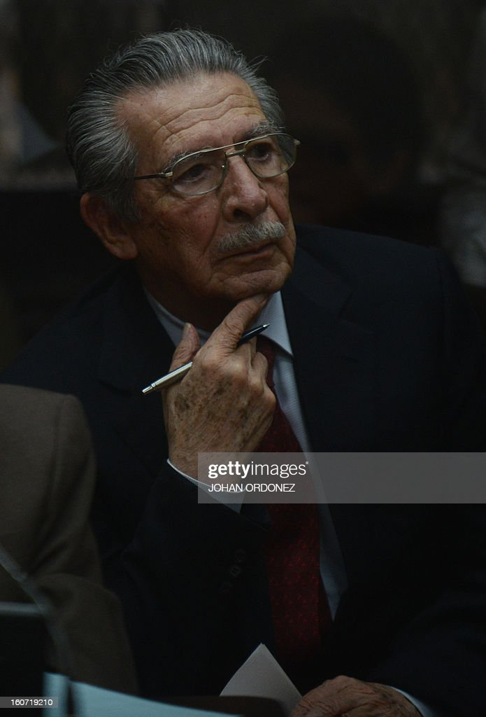 Former Guatemalan de facto President (1982-1983) and retired General Jose Efrain Rios Montt(R) is seen during a court hearing in Guatemala City on Febrary 4, 2013. Guatemalan judge Miguel Galvez defined this Monday the court members to prosecute Ríos Montt, on charges of genocide committed in indigenous populations during his de facto regime between 1982 and 1983. AFP PHOTO/Johan ORDONEZ
