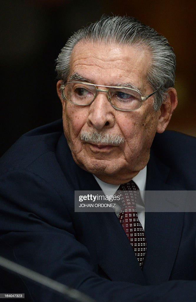 Former Guatemalan de facto President (1982-1983), retired General Jose Efrain Rios Montt, 86, is seen during the opening trial on charges of genocide during his de facto 1982-83 regime, in Guatemala City on March 19, 2013. Rios Montt, who stands trial despite defense attempts to postpone the start of the historic proceedings, is accused of ordering the execution of 1,771 members of the indigenous Ixil Maya people in the Quiche region. The trial marks the first time genocide proceedings have been brought in relation to the 36-year civil war in Guatemala that ended in 1996, leaving an estimated 200,000 people dead, according to United Nations estimates. AFP PHOTO/Johan ORDONEZ