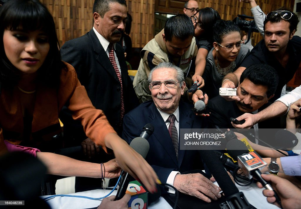 Former Guatemalan de facto President (1982-1983), retired General Jose Efrain Rios Montt, 86, is hounded by journalists just before the opening of the trial on charges of genocide during his de facto 1982-83 regime, in Guatemala City on March 19, 2013. Rios Montt, who stands trial despite defense attempts to postpone the start of the historic proceedings, is accused of ordering the execution of 1,771 members of the indigenous Ixil Maya people in the Quiche region. The trial marks the first time genocide proceedings have been brought in relation to the 36-year civil war in Guatemala that ended in 1996, leaving an estimated 200,000 people dead, according to United Nations estimates. AFP PHOTO/Johan ORDONEZ