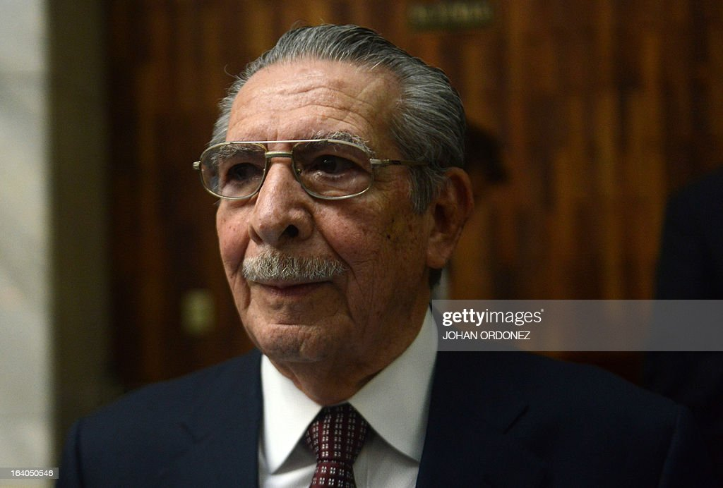 Former Guatemalan de facto President (1982-1983), retired General Jose Efrain Rios Montt, 86, arrives in court for the trial on charges of genocide during his de facto 1982-83 regime, in Guatemala City on March 19, 2013. Rios Montt, who stands trial despite defense attempts to postpone the start of the historic proceedings, is accused of ordering the execution of 1,771 members of the indigenous Ixil Maya people in the Quiche region. The trial marks the first time genocide proceedings have been brought in relation to the 36-year civil war in Guatemala that ended in 1996, leaving an estimated 200,000 people dead, according to United Nations estimates. AFP PHOTO/Johan ORDONEZ