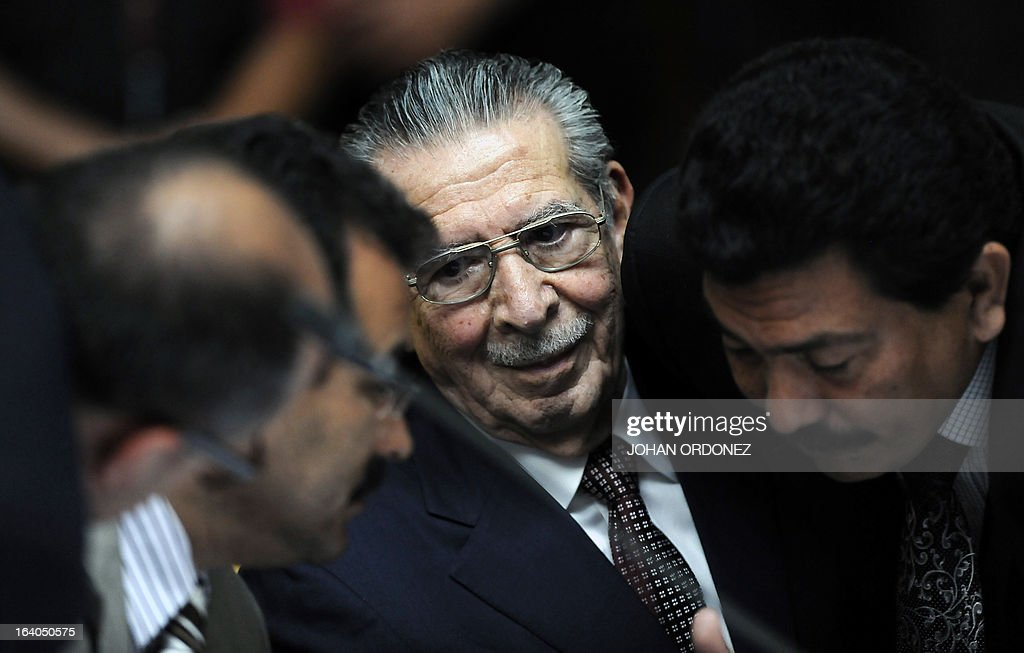 Former Guatemalan de facto President (1982-1983), retired General Jose Efrain Rios Montt, 86, speaks with his lawyers during the opening of the trial on charges of genocide during his de facto 1982-83 regime, in Guatemala City on March 19, 2013. Rios Montt, who stands trial despite defense attempts to postpone the start of the historic proceedings, is accused of ordering the execution of 1,771 members of the indigenous Ixil Maya people in the Quiche region. The trial marks the first time genocide proceedings have been brought in relation to the 36-year civil war in Guatemala that ended in 1996, leaving an estimated 200,000 people dead, according to United Nations estimates. AFP PHOTO/Johan ORDONEZ