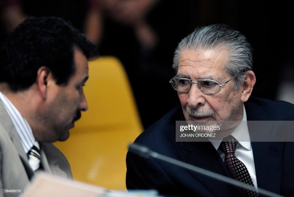 Former Guatemalan de facto President (1982-1983), retired General Jose Efrain Rios Montt, 86, speaks with one of his lawyers during the opening of the trial on charges of genocide in his de facto 1982-83 regime, in Guatemala City on March 19, 2013. Rios Montt, who stands trial despite defense attempts to postpone the start of the historic proceedings, is accused of ordering the execution of 1,771 members of the indigenous Ixil Maya people in the Quiche region. The trial marks the first time genocide proceedings have been brought in relation to the 36-year civil war in Guatemala that ended in 1996, leaving an estimated 200,000 people dead, according to United Nations estimates. AFP PHOTO/Johan ORDONEZ