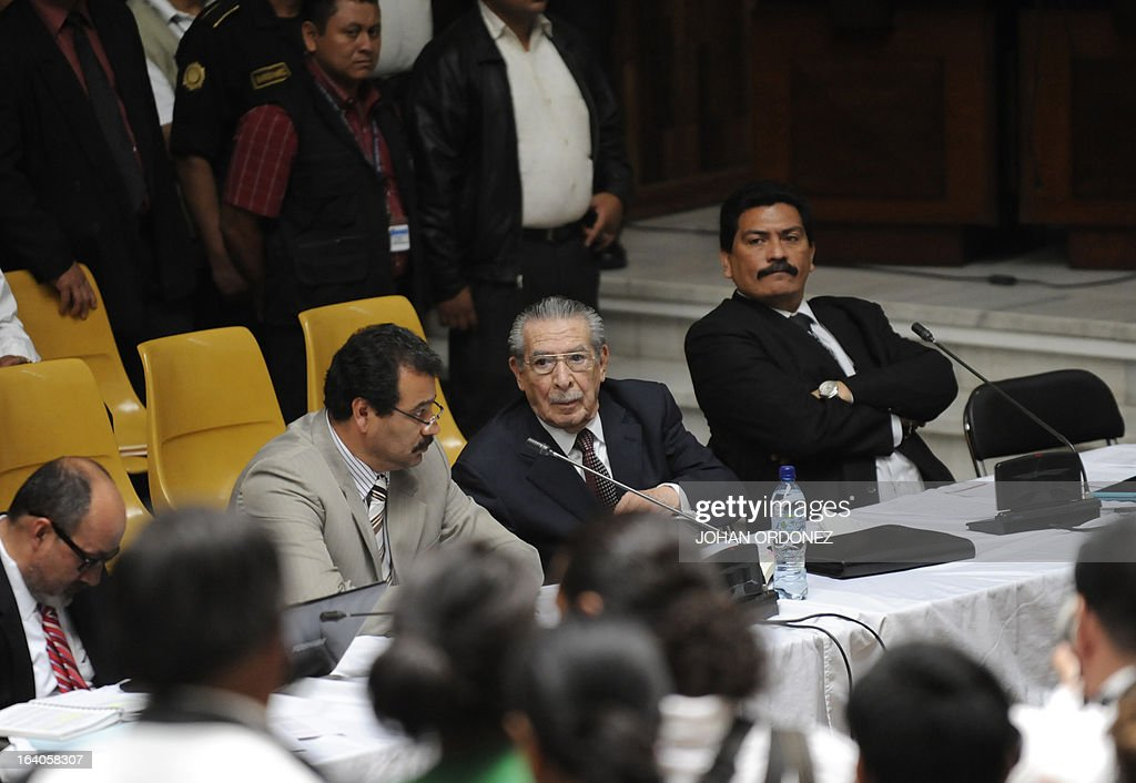 Former Guatemalan de facto President (1982-1983), retired General Jose Efrain Rios Montt(C), 86, is seen during the opening of the trial on charges of genocide during his de facto 1982-83 regime, in Guatemala City on March 19, 2013. Rios Montt, who stands trial despite defense attempts to postpone the start of the historic proceedings, is accused of ordering the execution of 1,771 members of the indigenous Ixil Maya people in the Quiche region. The trial marks the first time genocide proceedings have been brought in relation to the 36-year civil war in Guatemala that ended in 1996, leaving an estimated 200,000 people dead, according to United Nations estimates. AFP PHOTO/Johan ORDONEZ
