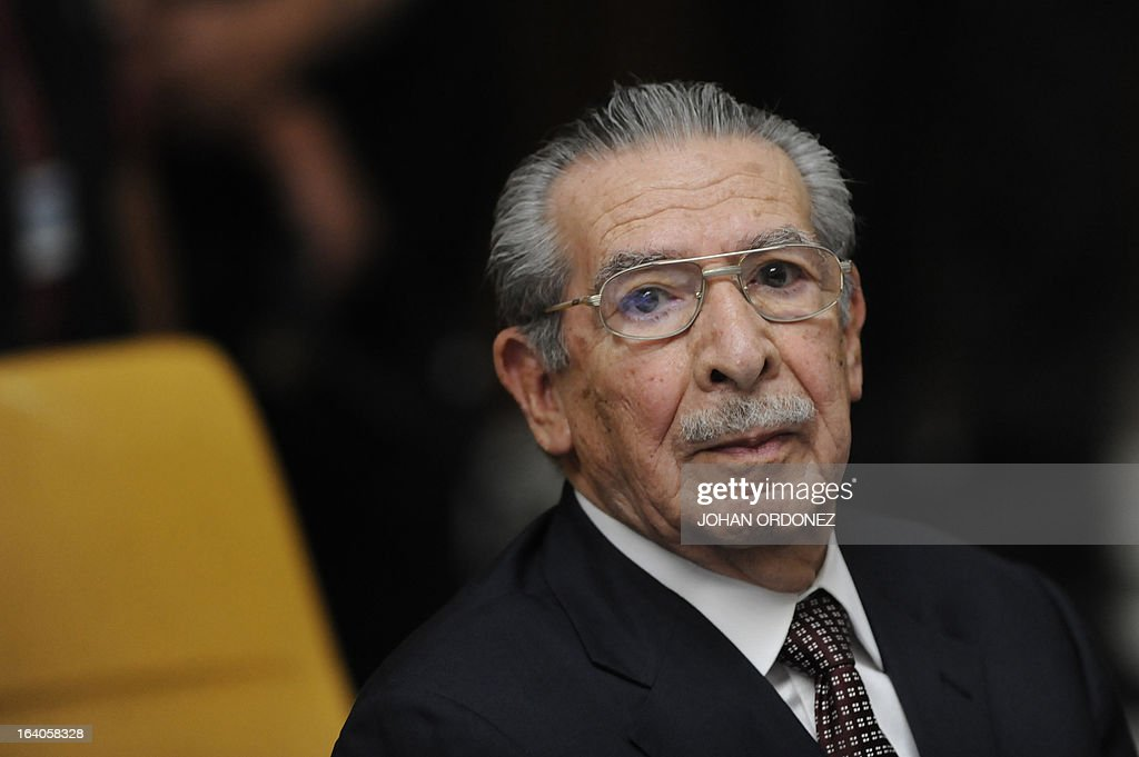 Former Guatemalan de facto President (1982-1983), retired General Jose Efrain Rios Montt, 86, listens during the opening of the trial on charges of genocide during his de facto 1982-83 regime, in Guatemala City on March 19, 2013. Rios Montt, who stands trial despite defense attempts to postpone the start of the historic proceedings, is accused of ordering the execution of 1,771 members of the indigenous Ixil Maya people in the Quiche region. The trial marks the first time genocide proceedings have been brought in relation to the 36-year civil war in Guatemala that ended in 1996, leaving an estimated 200,000 people dead, according to United Nations estimates. AFP PHOTO/Johan ORDONEZ