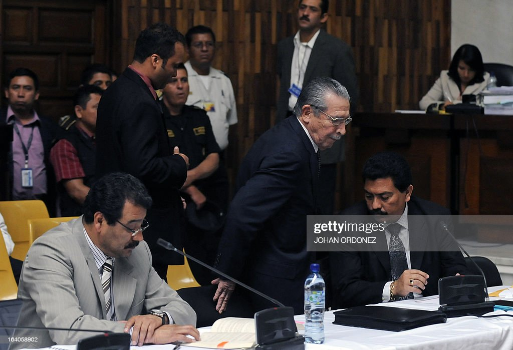 Former Guatemalan de facto President (1982-1983), retired General Jose Efrain Rios Montt (C), 86, is seen during the opening of the trial on charges of genocide during his de facto 1982-83 regime, in Guatemala City on March 19, 2013. Rios Montt, who stands trial despite defense attempts to postpone the start of the historic proceedings, is accused of ordering the execution of 1,771 members of the indigenous Ixil Maya people in the Quiche region. The trial marks the first time genocide proceedings have been brought in relation to the 36-year civil war in Guatemala that ended in 1996, leaving an estimated 200,000 people dead, according to United Nations estimates. AFP PHOTO/Johan ORDONEZ