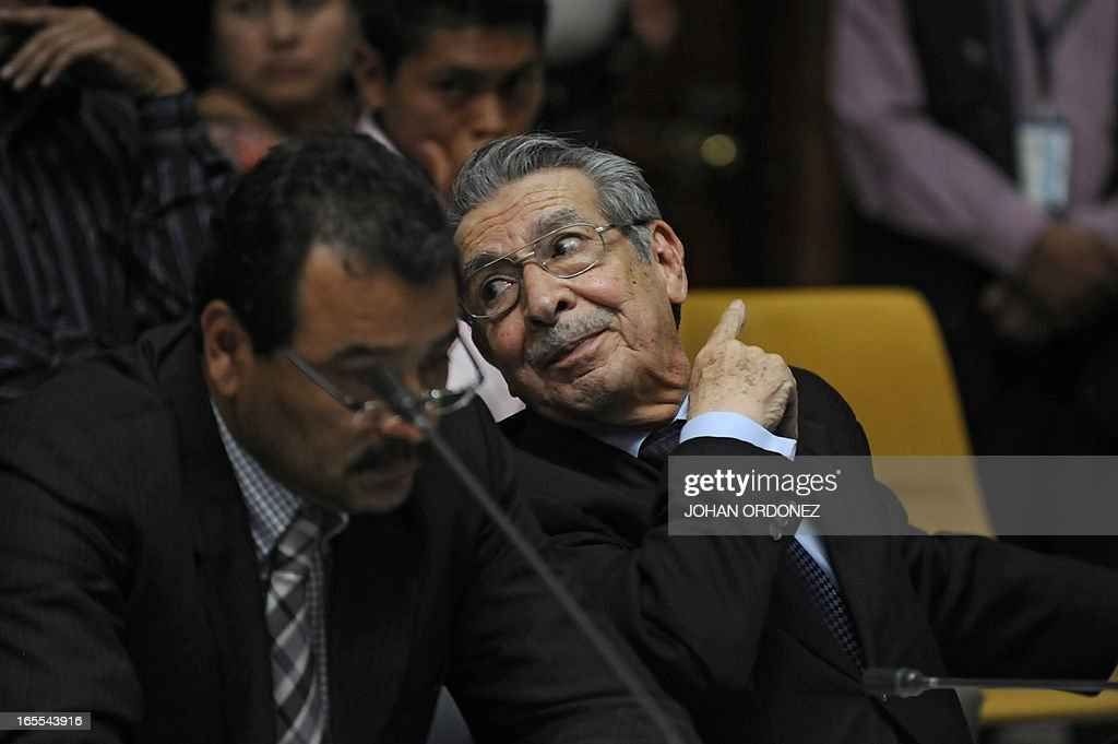 Former Guatemalan de facto President (1982-1983), retired General Jose Efrain Rios Montt (R), listens to testimonies through a video-conference of former military man Hugo Leonardo (out frame) during his trial in Guatemala City on April 4, 2013. Rios Montt, who stands trial despite defense attempts to postpone the start of the historic proceedings, is accused of ordering the execution of 1,771 members of the indigenous Ixil Maya people in the Quiche region. Rios Montt refrained from testifying. AFP PHOTO/Johan ORDONEZ