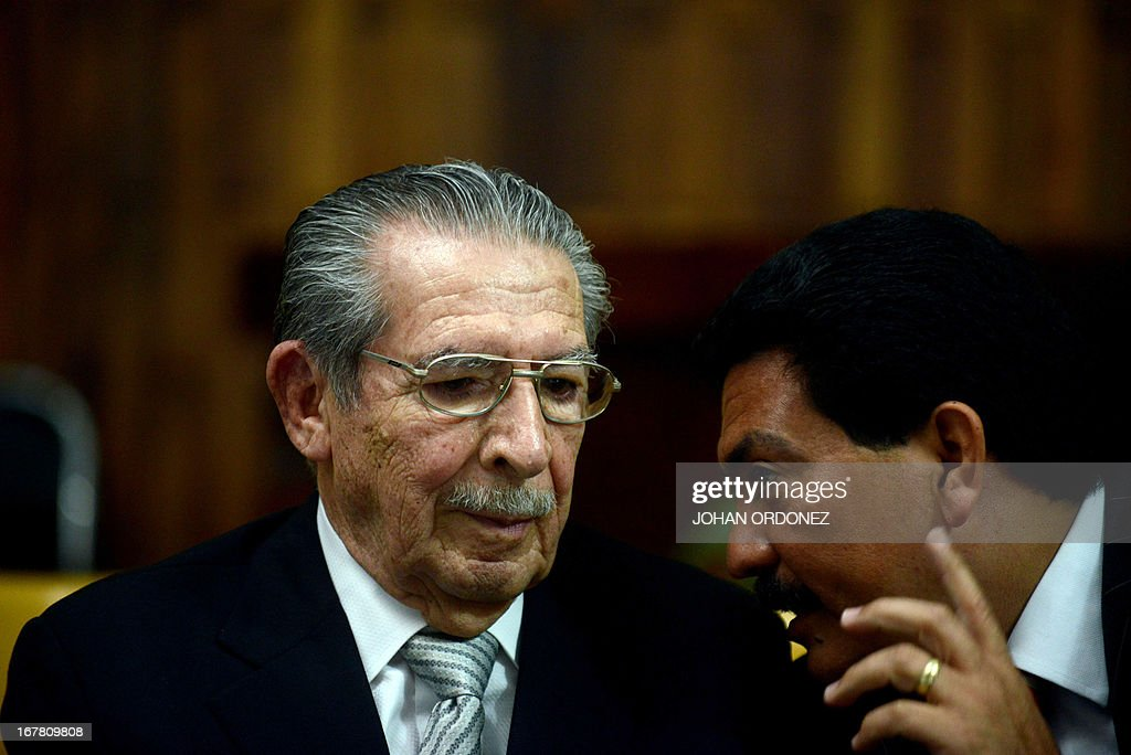 Former Guatemalan de facto President (1982-1983), retired General Jose Efrain Rios Montt (L), 86, listens to his lawyer Francisco Garcia during the trial acainst him on charges of genocide committed during his de facto regime, in Guatemala City on April 30, 2013. The genocide trial arises from the country's 36-year civil war, which pitted leftist guerrillas against government forces until 1996, leaving an estimated 200,000 dead or 'disappeared,' according to the United Nations. Rios Montt, 86, is accused of ordering the execution of 1,771 members of the Ixil Maya people in the Quiche region during his 1982-1983 regime. AFP PHOTO/Johan ORDONEZ