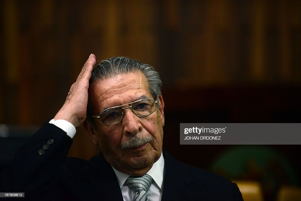 Former Guatemalan de facto President (1982-1983), retired General Jose Efrain Rios Montt, 86, gestures during the trial acainst him on charges of genocide committed during his de facto regime, in Guatemala City on April 30, 2013. The genocide trial arises from the country's 36-year civil war, which pitted leftist guerrillas against government forces until 1996, leaving an estimated 200,000 dead or 'disappeared,' according to the United Nations. Rios Montt, 86, is accused of ordering the execution of 1,771 members of the Ixil Maya people in the Quiche region during his 1982-1983 regime. AFP PHOTO/Johan ORDONEZ