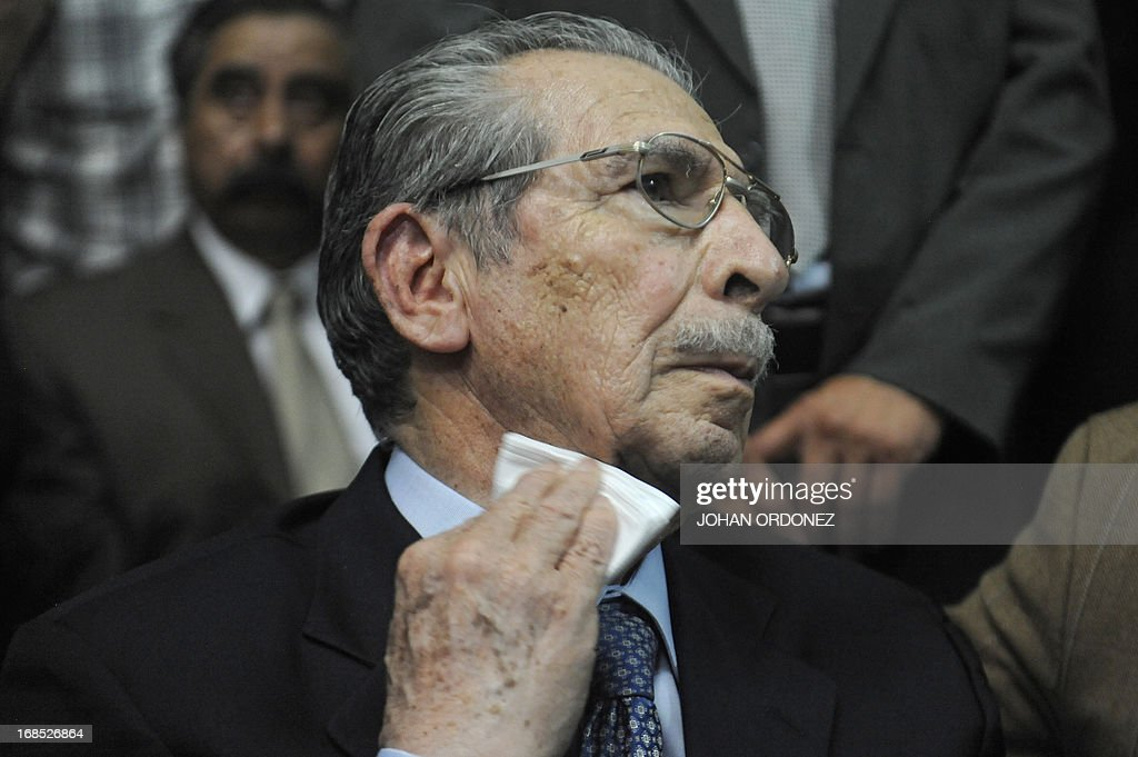 Former Guatemalan de facto President (1982-1983), retired General Jose Efrain Rios Montt, 86, gestures after listening his sentence during the trial against him on charges of genocide committed during his regime, in Guatemala City, on May 10, 2013. Rios Montt was found guilty of genocide and war crimes on Friday in a landmark ruling stemming from massacres of indigenous people in his country's long civil war. Rios Montt thus became the first Latin American convicted of trying to exterminate an entire group of people in a brief but particularly gruesome stretch of a war that started in 1960, lasted 36 years and left around 200,000 people dead or missing. AFP PHOTO / Johan ORDONEZ