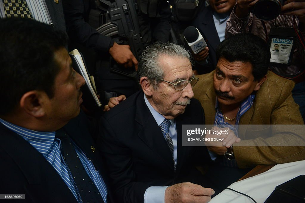 Former Guatemalan de facto President (1982-1983), retired General Jose Efrain Rios Montt, 86, speaks with his lawyers after listening his sentence during the trial against him on charges of genocide committed during his regime, in Guatemala City, on May 10, 2013. Rios Montt was found guilty of genocide and war crimes on Friday in a landmark ruling stemming from massacres of indigenous people in his country's long civil war. Rios Montt thus became the first Latin American convicted of trying to exterminate an entire group of people in a brief but particularly gruesome stretch of a war that started in 1960, lasted 36 years and left around 200,000 people dead or missing. AFP PHOTO / Johan ORDONEZ