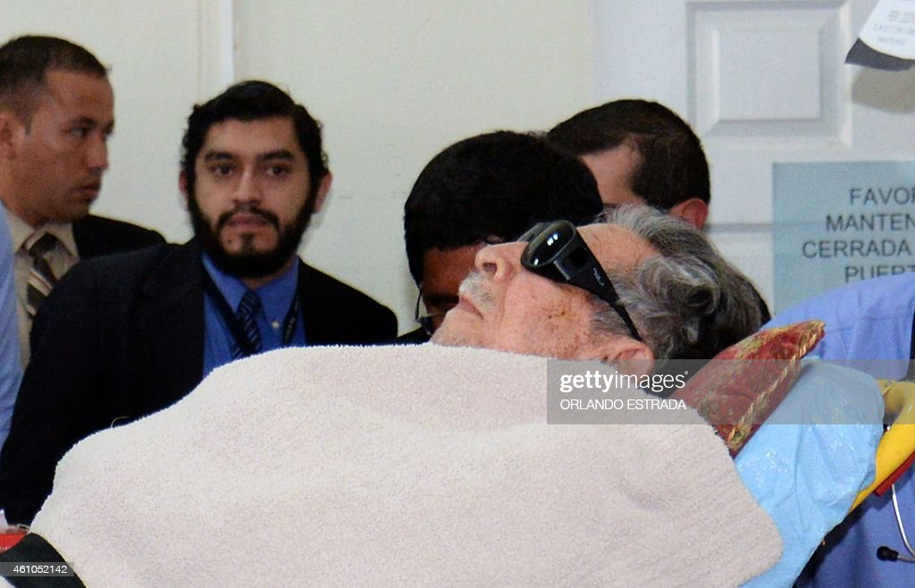 Former Guatemalan de facto president (1982-1983), retired General Jose Efrain Rios Montt, arrives on a stretcher as a retrial against him opens in Guatemala City, on January 5, 2015. The retrial in genocide case against former dictator Efrain Rios Montt, accused of killing 1,771 indigenous people during his regime in the early 1980s, opens today after the Constitutional Court overturned his 80-year-conviction on procedural grounds in 2013. AFP PHOTO / Orlando ESTRADA