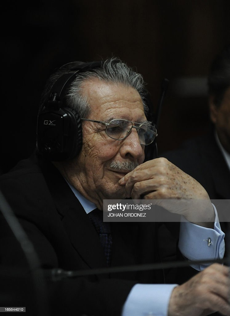 Former Guatemalan dictador (1982-1983), General (retired) Jose Efrain Rios Montt (R), listens to the testimony given through a video-conference from former military Hugo Leonardo during his trial in Guatemala City on April 4, 2013. Rios Montt, who stands trial despite defense attempts to postpone the start of the historic proceedings, is accused of ordering the execution of 1,771 members of the indigenous Ixil Maya people in the Quiche region. Rios Montt refrained from testifying. AFP PHOTO/Johan ORDONE