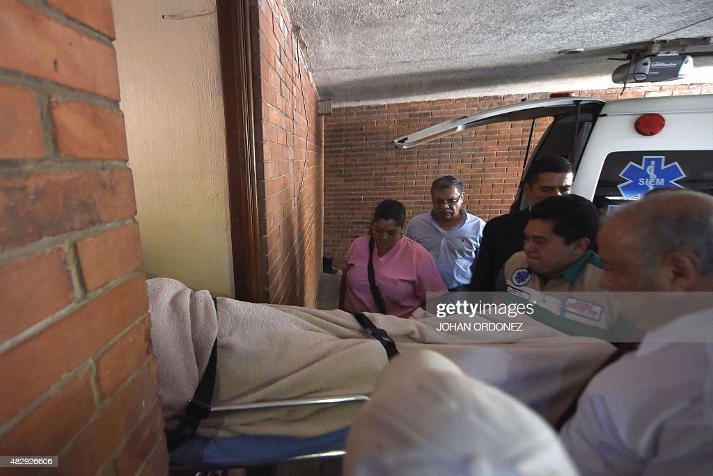Former Guatemalan dictator Jose Efrain Rios Montt arrives on a trolley at a private clinic in Guatemala City on August 4 2015 to be submitted by...