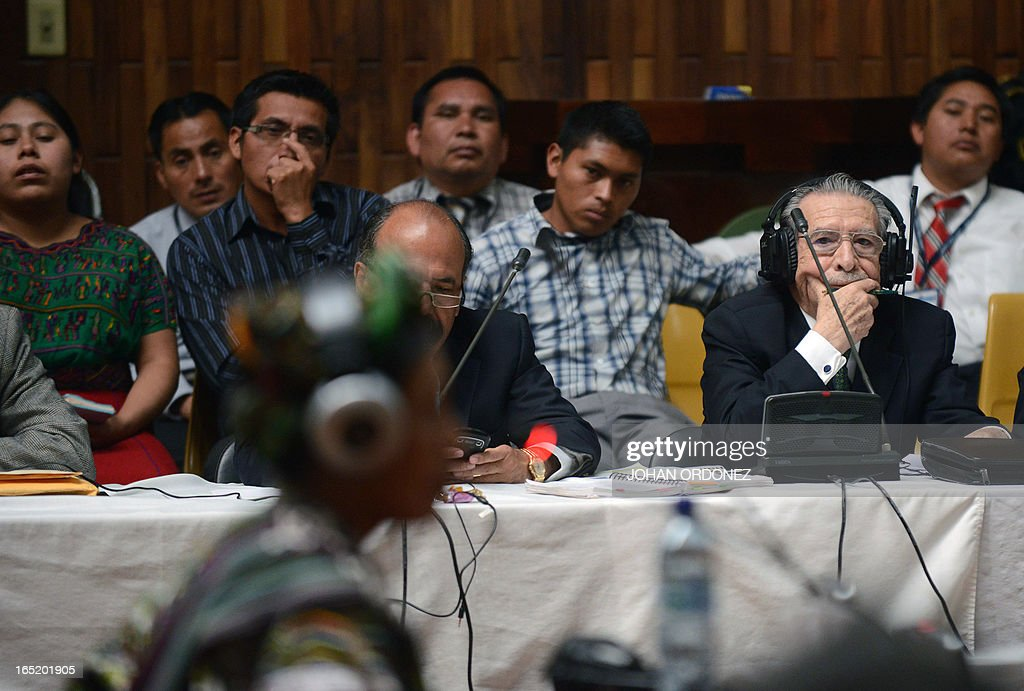 Former Guatemalan dictator (1982-1983), retired General Jose Efrain Rios Montt (R), 86, gestures while witness Ana de Leon testifies during his trial on charges of genocide in Guatemala City on April 1, 2013. Rios Montt, who stands trial despite defense attempts to postpone the start of the historic proceedings, is accused of ordering the execution of 1,771 members of the indigenous Ixil Maya people in the Quiche region. AFP PHOTO/Johan ORDONEZ
