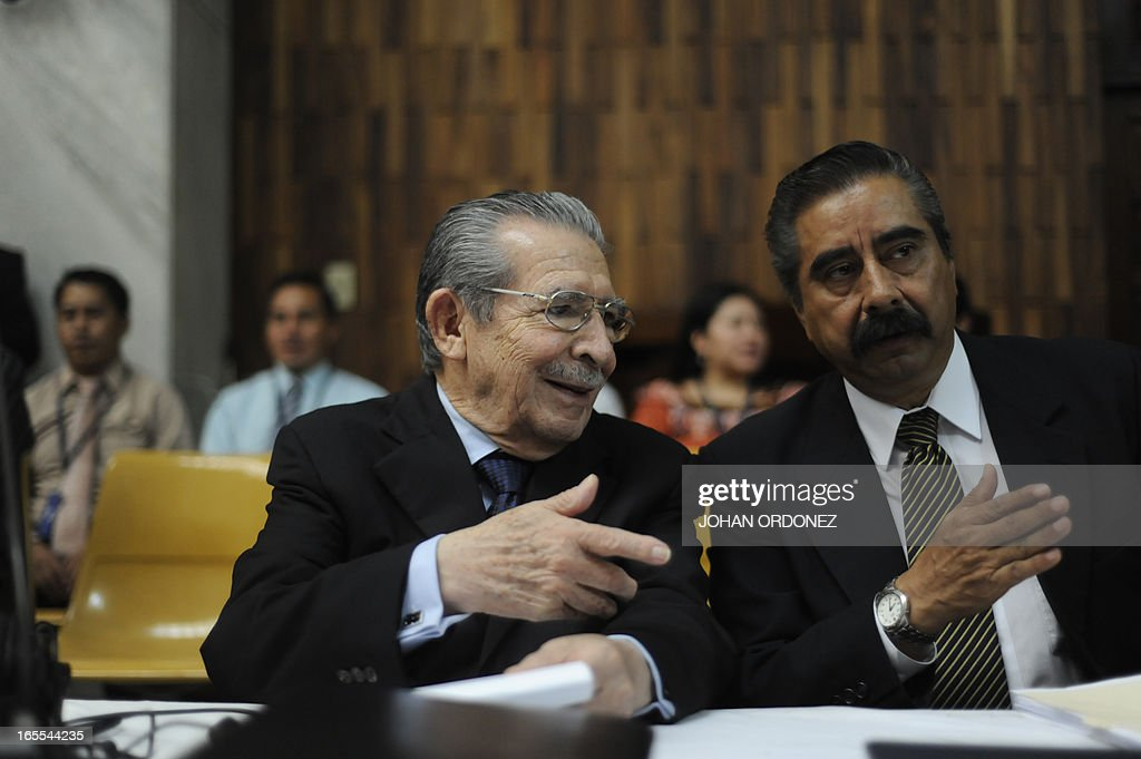 Former Guatemalan dictator (1982-1983), retired General Jose Efrain Rios Montt (L), speaks with Marco Antonio Cornejo, one of his lawyers, during his trial in Guatemala City on April 4, 2013. Rios Montt, who stands trial despite defense attempts to postpone the start of the historic proceedings, is accused of ordering the execution of 1,771 members of the indigenous Ixil Maya people in the Quiche region. Rios Montt refrained from testifying. AFP PHOTO/Johan ORDONEZ