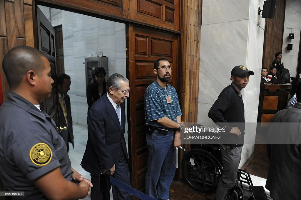 Former Guatemalan dictator (1982-1983), retired General Jose Efrain Rios Montt (2-L), arrives to court to be judged on charges of genocide in Guatemala City on April 2, 2013. Rios Montt, 86, who stands trial despite defense attempts to postpone the start of the historic proceedings, is accused of ordering the execution of 1,771 members of the indigenous Ixil Maya people in the Quiche region. AFP PHOTO/Johan ORDONEZ