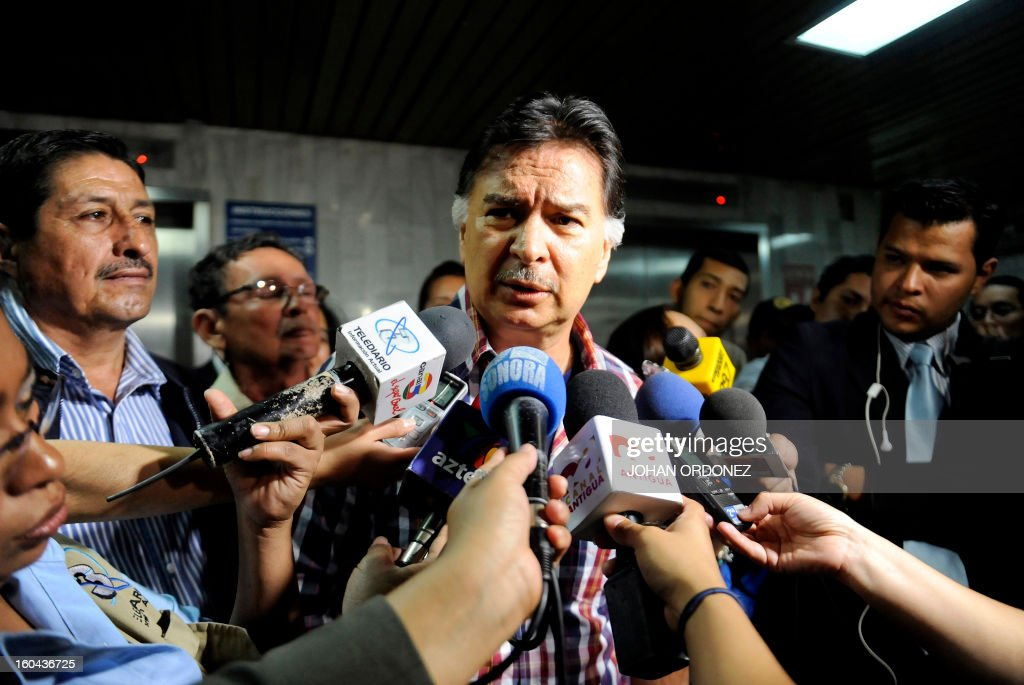 Former Guatemalan President (2000-2004) Alfonso Portillo speaks with journalists upon his arrival in court in Guatemala City on January 31, 2013. Portillo, on whose shoulders falls an extradition request from the US for money laundering, sued the State of Guatemala before the Inter-American Commission on Human Rights (CIDH) for alleged violations of his rights. AFP PHOTO/Johan ORDONEZ