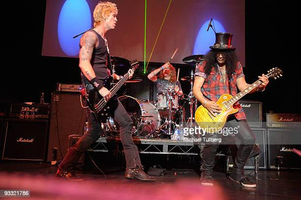 Former Guns N' Roses members Duff McKagan Steven Adler and Slash perform at the 'LAYN Rocks' benefit concert for the Los Angeles Youth Network held...