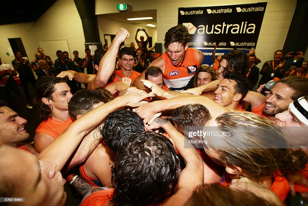 Former GWS Giants football manager Graeme Allan stands in the middle as the Giants sing their club song after victory in the round six AFL match between the Greater Western Sydney Giants and the Hawthorn Hawks at Spotless Stadium on April 30, 2016 in Sydney, Australia.