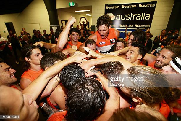 Former GWS Giants football manager Graeme Allan stands in the middle as the Giants sing their club song after victory in the round six AFL match...