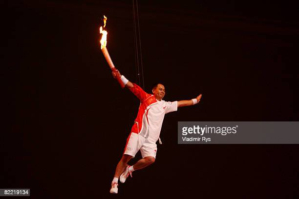 Former gymnast Li Ning is lifted with the torch to light the Olympic Flame during the Opening Ceremony for the 2008 Beijing Summer Olympics at the...