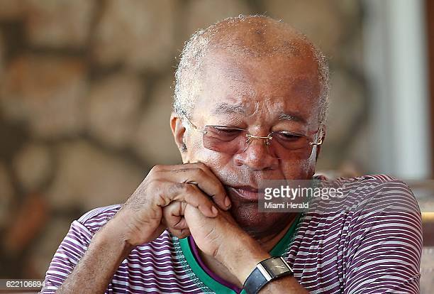 Former Haiti Prime Minister Jean Marie Cherestal breaks down on October 11 as he talks about the damage Hurricane Matthew brought to the area and...