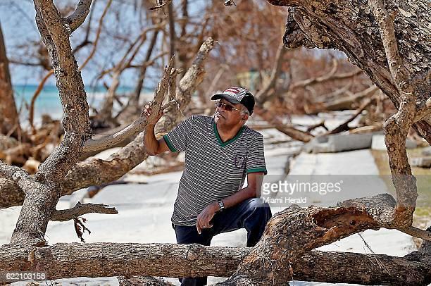 Former Haiti Prime Minister Jean Marie Cherestal surveys the damage near his hotel in Port Salut Haiti on October 11 2016
