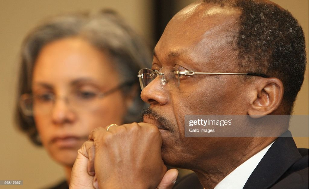 Former Haitian president, Jean Bertrand Aristide during a press conference at the Southern Sun hotel on January 15 2010 in Johannesburg, South Africa. An emotional Aristide spoke about the situation in Haiti in the wake of a devastating earthquake. His wife Mildred, who was seated beside him, fought back tears as she held onto his arm. Haiti, the poorest country in the western hemisphere, was struck by a powerful earthquake on Tuesday that virtually flattened the capital Port-au-Prince.