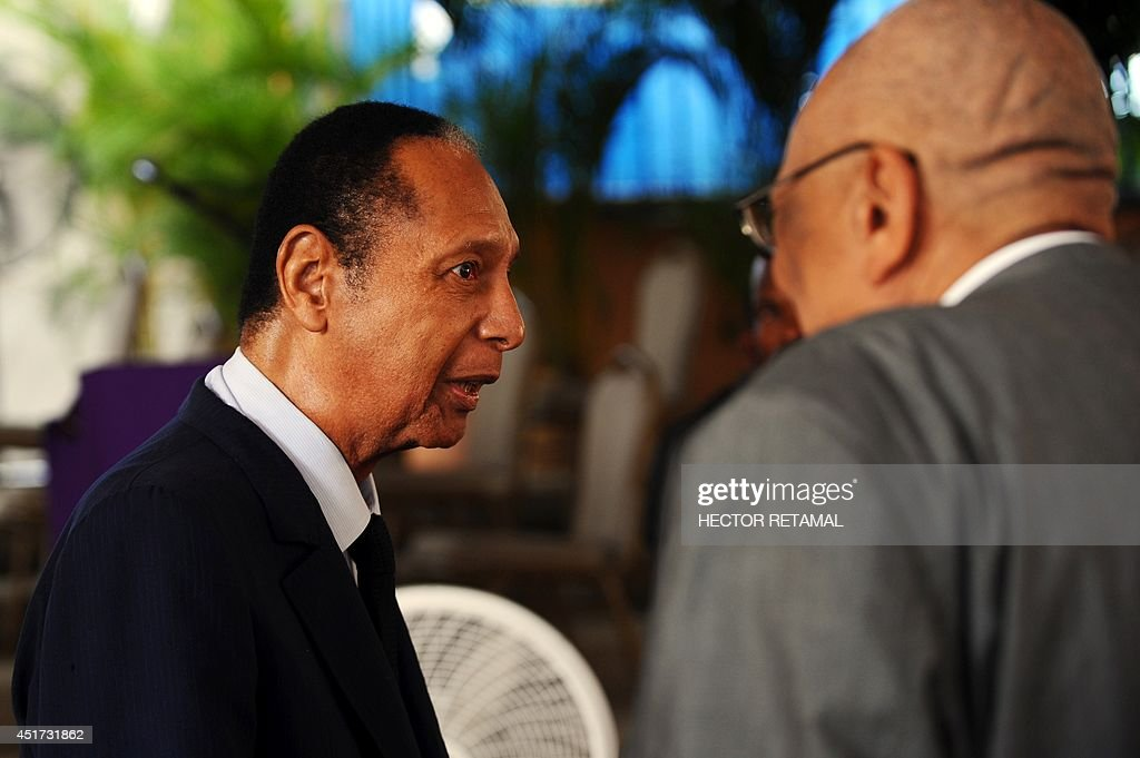 Former Haitian President Jean-Claude 'Baby Doc' Duvalier attends the funeral of former Haitian President Leslie Manigat in Port-au-Prince on July 5, 2014. Three days of mourning have been declared in Haiti for Manigat, who died on June 27. He was 83. AFP PHOTO/Hector RETAMAL