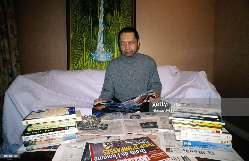 Former Haitian President <a gi-track='captionPersonalityLinkClicked' href=/galleries/search?phrase=Jean-Claude+Duvalier&family=editorial&specificpeople=2596261 ng-click='$event.stopPropagation()'>Jean-Claude Duvalier</a> reads a magazine, December 1998, in France. Duvalier has recently returned to his homeland for the first time in 25 years after his exile in France.
