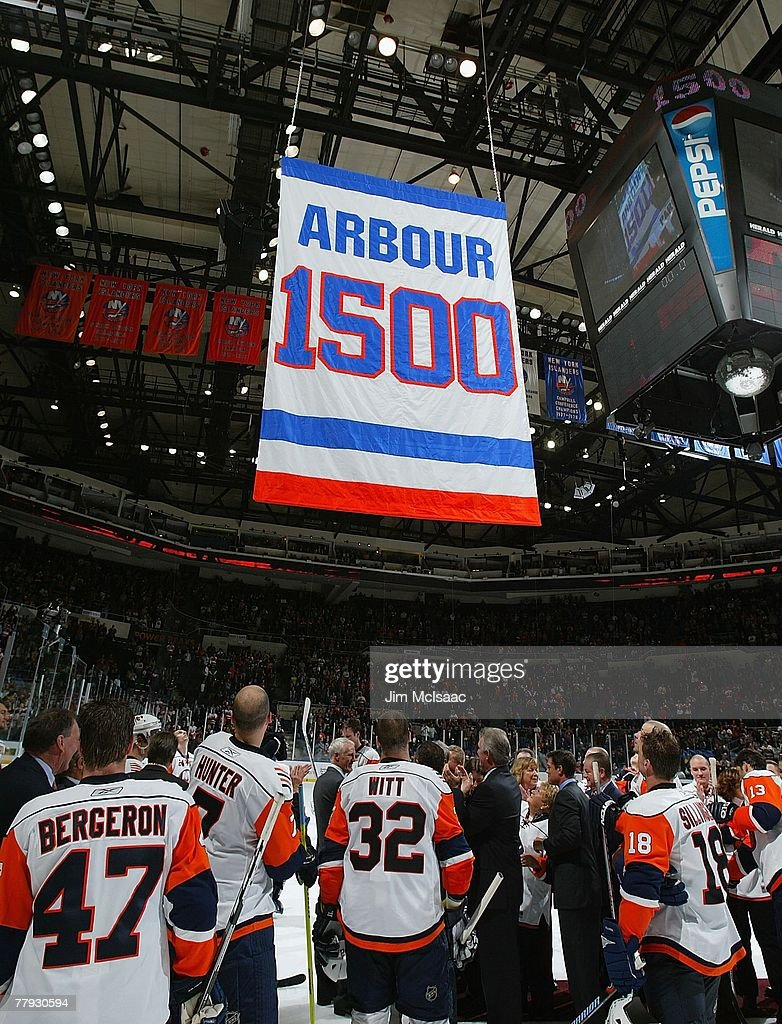 Former head coach Al Arbour of the New York Islanders watches a banner rise to the rafters honoring his 1500th game coached with the team after...