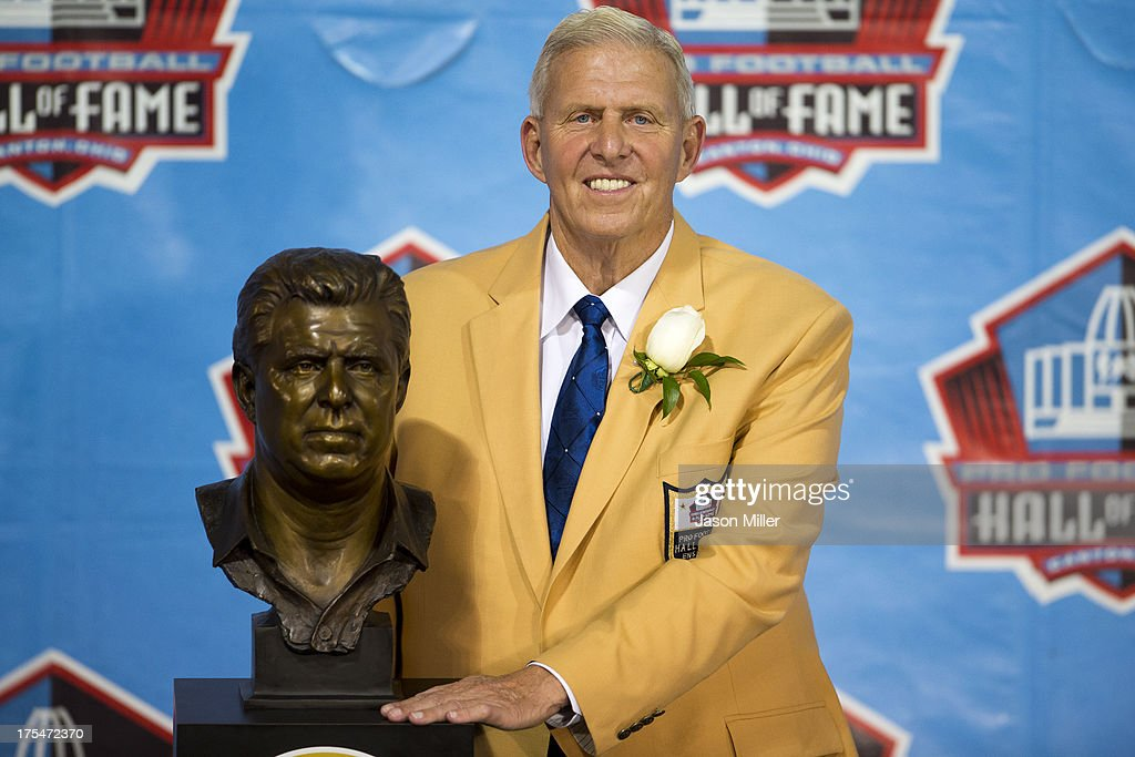 Former head coach Bill Parcells poses with his Hall of Fame bust during the NFL Class of 2013 Enshrinement Ceremony at Fawcett Stadium on Aug. 3, 2013 in Canton, Ohio.