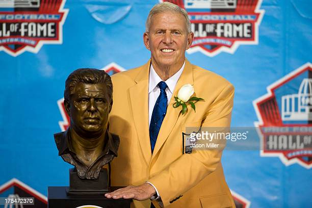 Former head coach Bill Parcells poses with his Hall of Fame bust during the NFL Class of 2013 Enshrinement Ceremony at Fawcett Stadium on Aug 3 2013...