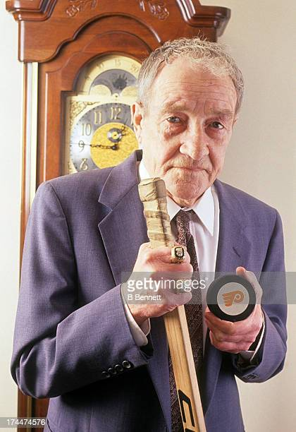 Former head coach Fred Shero of the Philadelphia Flyers and New York Rangers poses with a hockey stick his two Stanely Cup Finals rings and a...