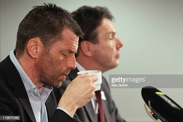Former head coach Michael Skibbe and CEO Heribert Bruchhagen attend a press conference of Eintracht Frankfurt at the Commerzbank Arena on March 22...
